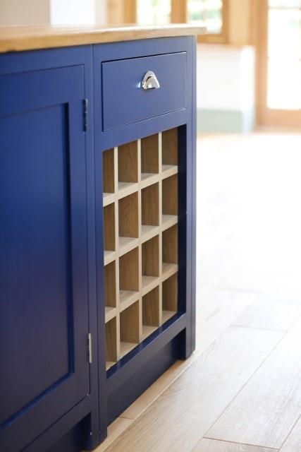 bespoke wine rack in blue kitchen cabinets